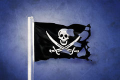 Torn Jolly Roger Pirate flag blowing in the wind Royalty Free Stock Photography