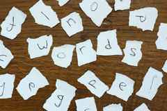 Torn letters against wood background Royalty Free Stock Photography
