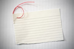Torn lined paper. With red wire in shape of number six over data paper sheet, vignetted horizontal shot Royalty Free Stock Images