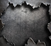 Torn metal with big ripped hole. Torn grunge metal background with ripped hole Stock Photo