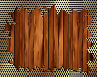 Torn metal grille on a wooden background Stock Photo
