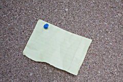 Torn note on cork bulletin board Royalty Free Stock Photo