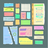 Torn off Paper Sheets with Hand Drawn Symbols Royalty Free Stock Images