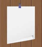 The torn off sheet of paper on wooden Royalty Free Stock Photos