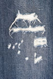 Torn old blue jeans background Royalty Free Stock Image