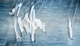 Torn old blue jeans texture Royalty Free Stock Photography