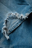 Torn old jeans Stock Images