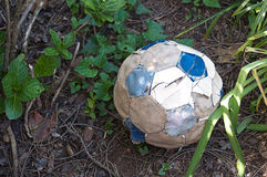 Torn Old Soccer Ball Stock Photos