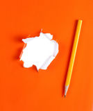 Torn orange paper hole. Tearing Inside white Stock Photos