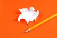 Torn orange paper hole. Tearing Inside white Royalty Free Stock Photo