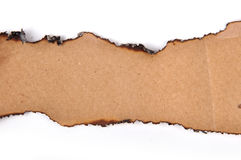 Torn Paper. Brown fired torn paper on white stock photos
