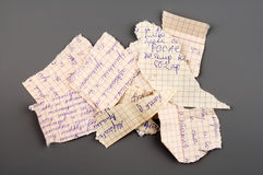 Torn paper. Small group of torn notebook paper isolated over grey Stock Photos
