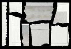Torn paper. Pieces of torn paper on black. Copy space stock images