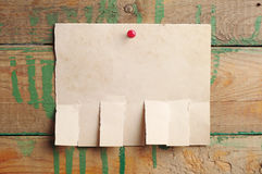 Torn paper for ads. On old wooden background stock image