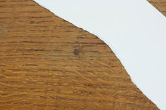 Torn paper against wood background Royalty Free Stock Photo