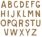 Torn paper alphabet letters. Brown torn paper alphabet letters Royalty Free Stock Photography