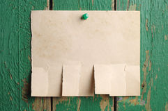 Torn paper for announcement. On old wooden background Royalty Free Stock Photos