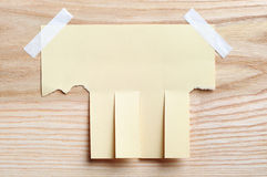 Torn paper for announcement. On a wooden background Royalty Free Stock Photography