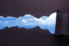 Torn Paper with blue sky background Royalty Free Stock Images