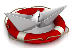 Torn paper boat in the lifebuoy Royalty Free Stock Images
