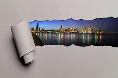 Torn Paper With Chicago Skyline. At dusk Royalty Free Stock Photo