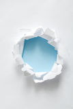Torn paper circle on blue Stock Images