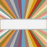 Torn paper with colorful retro rays Royalty Free Stock Images