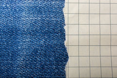 Torn paper  on a denim canvas Royalty Free Stock Photography