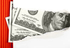 Torn paper and dollars Stock Photo