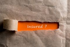 Torn paper envelope with question - insured. Insurance concept.  Stock Image