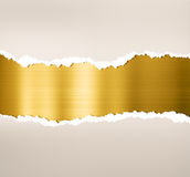 Torn paper with gold metal plate background Royalty Free Stock Photography