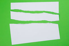 Torn paper on green background Royalty Free Stock Photo