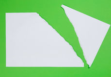 Torn paper on green background Royalty Free Stock Photography