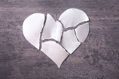 Torn paper heart on grey background. Relationship problems Royalty Free Stock Image