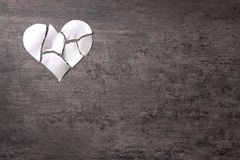 Torn paper heart on grey background. Relationship problems Royalty Free Stock Images