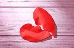 Torn paper heart on wooden background. Relationship problems Royalty Free Stock Photo