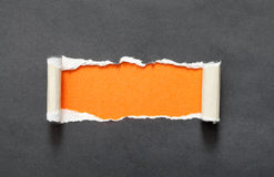 Torn paper with orange space for your message Royalty Free Stock Image
