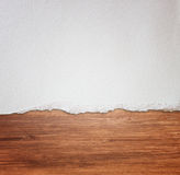 Torn paper over wooden background. Pic stock images