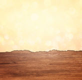 Torn paper over wooden textured background Royalty Free Stock Image