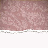 Torn paper with a paisley pattern. Royalty Free Stock Image