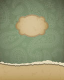 Torn paper with a paisley pattern. Royalty Free Stock Images
