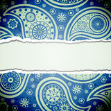 Torn paper with a paisley pattern. Royalty Free Stock Photos