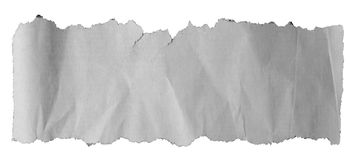 Torn paper piece. Piece of torn paper on plain background Royalty Free Stock Images