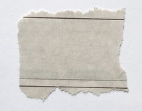 Torn paper. Piece of torn paper on plain background stock photos