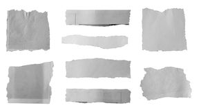 Torn paper pieces. Pieces of torn paper on plain background Royalty Free Stock Photography