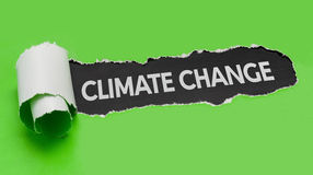 Torn paper revealing the word Climate change Stock Images