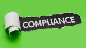 Torn paper revealing the word Compliance Royalty Free Stock Photos