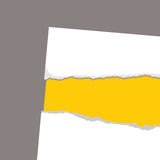 Torn paper revela yellow Royalty Free Stock Photo