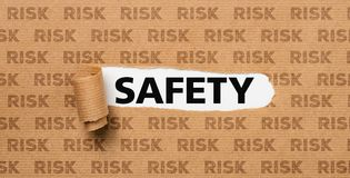 Torn Paper - Safety or Risk stock images
