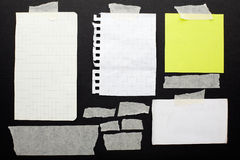 Torn paper scraps set and tape. On black background with clipping path Stock Images